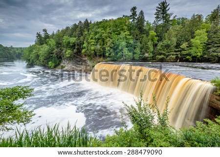 Tahquamenon Falls in Michigan's eastern Upper Peninsula.  This beautiful waterfall is said to be the second largest in the United States east of the Mississippi River. - stock photo