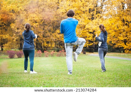 Tai chi training in a park in autumn