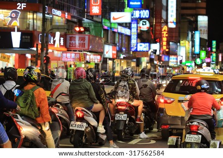 TAICHUNG;TAIWAN,APRIL 12: People and riders are busy on the street in Fengjia Night Market on 12 april 2015. Fengjia Night Market is one of the famous night market in Taiwan  - stock photo