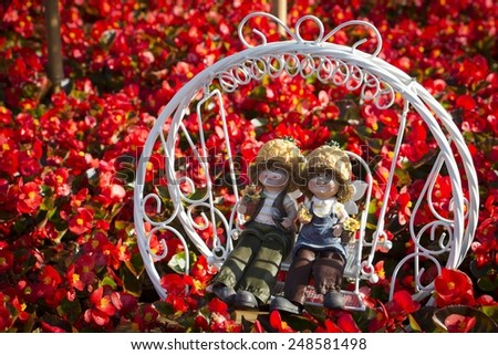 Taichung - Taiwan,Dolls in cluster of flowers - stock photo