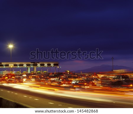 Tail backs of traffic at toll gate in California - stock photo