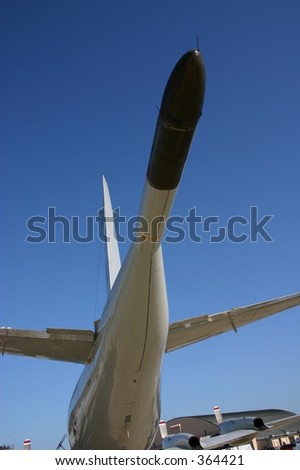 Tail boom of P-3 Orion Anti-Submarine Aircraft at Andrews Air Force Base - stock photo