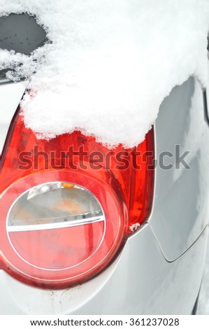 Tail light.Ice on the car light.Car under the snow - stock photo