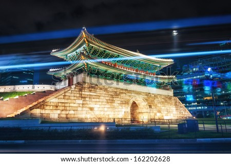 Tail lights streak by Namdaemun Gate in Seoul, South Korea. - stock photo