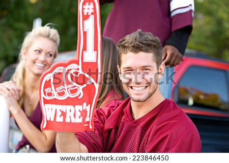 Tailgate: Fan Holds Up Number One Foam Finger - stock photo