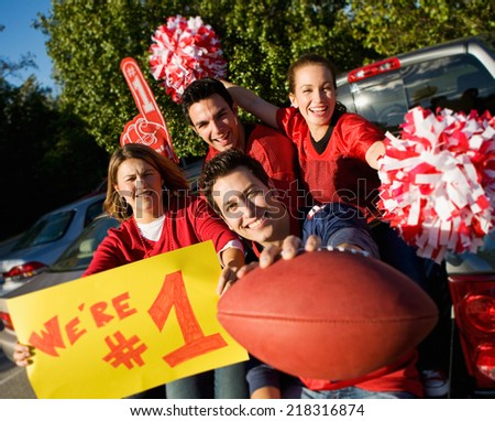 Tailgate: Football Fans Cheering For Their Team - stock photo
