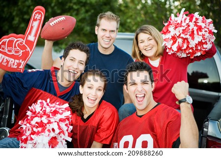 Tailgate: Group Of Excited Fans Cheer For Their Team - stock photo