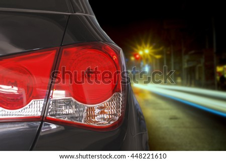 taillight and Car driving at night and Defocused night traffic lights for background ,soft focus - stock photo