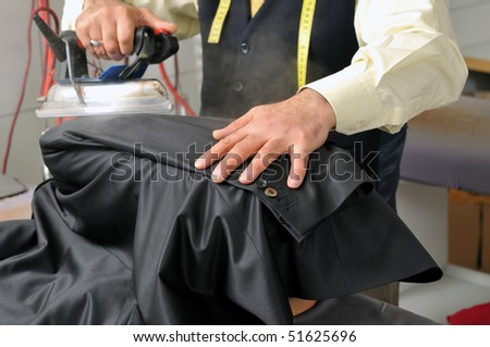 Tailor ironing a jacket - A series of TAILOR related images.