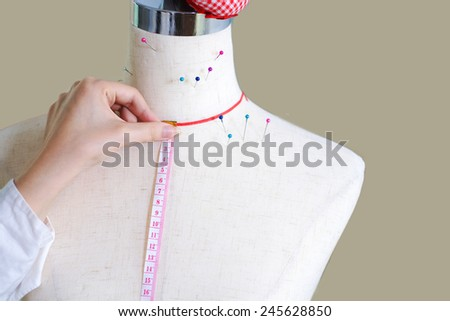 Tailor's dummy and ruler - stock photo