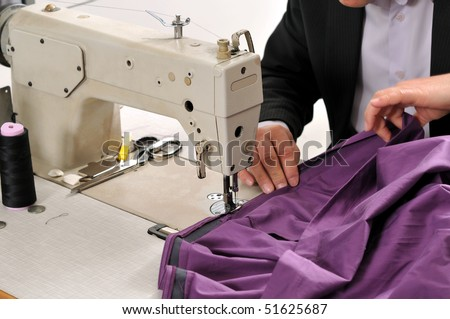 Tailor using industrial sewing machine - A series of TAILOR related images.