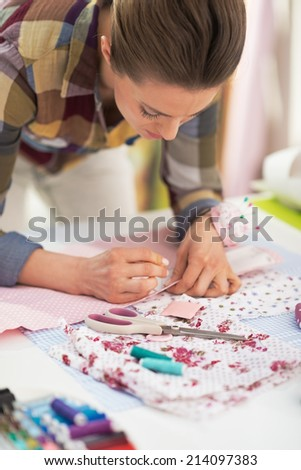 Tailor woman working with fabric