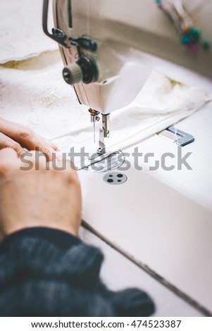 Tailor working on sewing machine