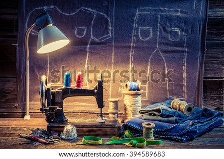 Tailor workshop with sewing machine, cloth and scissors