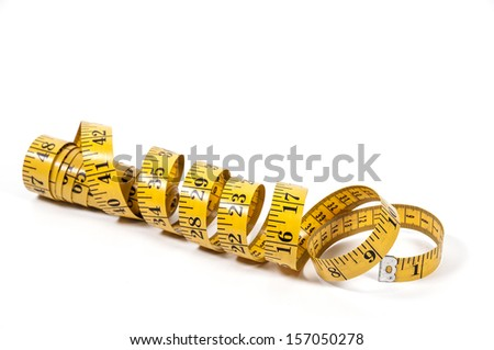 Tailors measuring tape coiled up randomly - stock photo