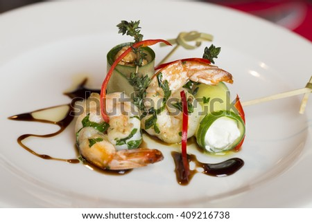 Tails of prawns with cucumber - stock photo