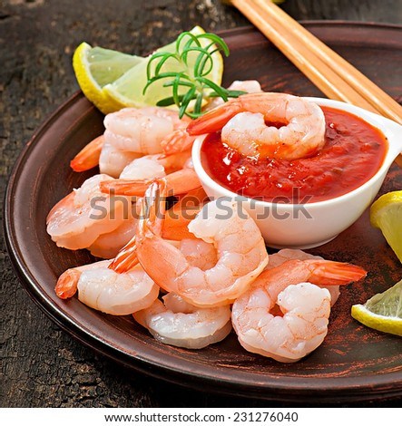 tails of shrimps with fresh lemon and rosemary  - stock photo