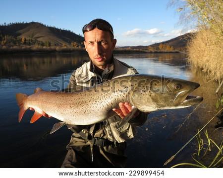 Taimen fishing - stock photo
