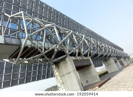 TAINAN, TAIWAN -- MARCH 4, 2014: A giant wall of solar panels is a distinctive feature of the National Museum of Taiwan History in Tainan City which was completed in 2012.