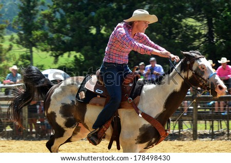 TAIPA, NZ - JAN 03:Woman rids a horse during barrel race on Jan 03 2014.Rodeo is a very popular sport in NZ where approximately 32 rodeos are held each summer. - stock photo