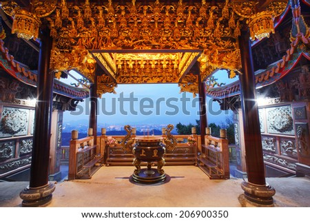 TAIPE, TAIWAN-JULY 14: Hunglodei Temple at night. It's one of the oldest temple in Taiwan on July 14, 2014. It has the largest status of Tudi Gong, the God of the earth in Taiwan (109 meters tall)