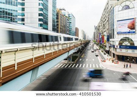 Taipei, Taiwan - April 22, 2016 : Street view of Taipei with metro train on the rail on April 22, 2016 in Taipei, Taiwan. the Taipei MRT is one of the best way to travel around the city.