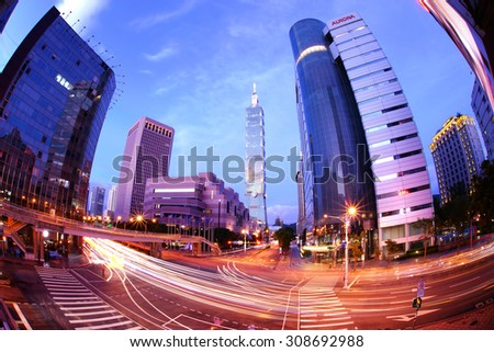 TAIPEI, TAIWAN - August 22: A fisheye shot to Taipei 101 in Xinyi financial district of Taipei city August 22, 2015 in Taipei, TW. Xinyi Distirict is the one of the most expensive area in Taipei. - stock photo