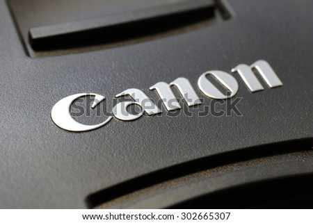 Taipei, Taiwan - August 3, 2015: Cap of Canon lens close up. Canon Inc. is a Japanese multinational corporation specialized in the manufacture of imaging and optical products,