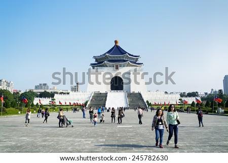 Taipei, Taiwan - Dec 29, 2014:Tourists at the Chiang Kai-Shek Memorial Hall in Taipei. Chiang Kai-shek Memorial Hall is a popular travel destination among tourists visiting Taiwan.  - stock photo