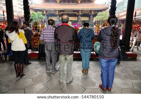 TAIPEI, TAIWAN - JAN 5, 2016. Many Taiwanese and tourists   come to Longshan Temple. The temple was built in Taipei in 1738 by settlers from Fujian during Qing rule.
