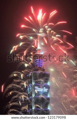 TAIPEI, TAIWAN - JANUARY 1: Fireworks on the famous Taipei 101 skyscraper celebrate the coming of new year 2013 on January 1, 2013 in Taipei, Taiwan. - stock photo