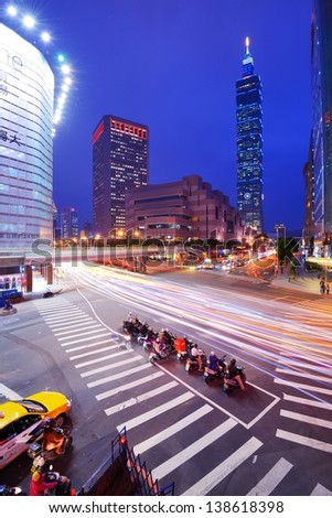 TAIPEI, TAIWAN - JANUARY 18: Traffic in the Xinyi District January 18, 2013 in Taipei, TW. Several key buildings such as Taipei 101 are located in Xinyi making it the financial district of the city. - stock photo