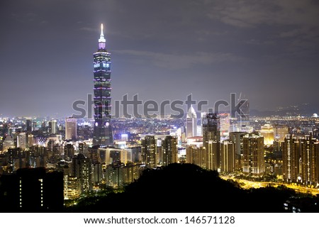 TAIPEI, TAIWAN - JULY 14: A night view to Taipei 101 from the Elephant Mountain near Xinyi  district after Typhoon Soulik hit Taipei city. The building is the world's second tallest at 509 meters.