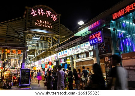TAIPEI, TAIWAN - JULY 14: Crowds flock to the entrance of Shilin Night Market in the Shilin District of Taipei July 14, 2013. Shilin Market is the most popular and largest night market in Taiwan.