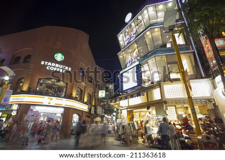 TAIPEI, TAIWAN - JULY 11: Crowds in Ximending District July 11, 2014 in Taipei, Taiwan. The district is a center of fashion culture and movie center for young people.