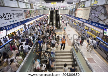 TAIPEI, TAIWAN - JULY 1: Passengers getting on and off on the platform of Taipe MRTon June 1, 2014 in Taipei. The Taipei MRT Subway is one of the best way to go ground and commute in Taipei city - stock photo