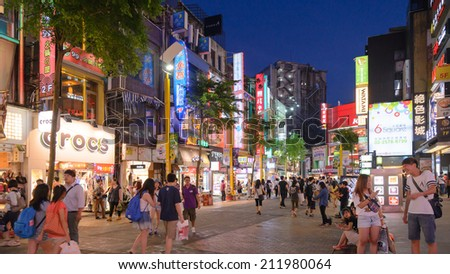 TAIPEI, TAIWAN - JULY 9: Ximending District JULY 9, 2014 in Taipei, TW. Originally developed during Japanese colonial rule, the district is now the source of Taiwan's fashion subculture. - stock photo