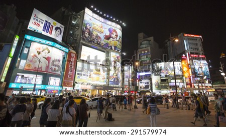 TAIPEI, TAIWAN - Jun 7: Crowds in Ximending District on June 7 2015 in Taipei, Taiwan. The district is a center of fashion culture and movie center for young people.