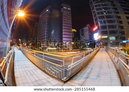 TAIPEI, TAIWAN - June 6: A fisheye shot to Taipei 101 in Xinyi financial district of Taipei city June 6, 2015 in Taipei, TW.  Xinyi Distirict is the one of the most expensive area in Taipei. - stock photo