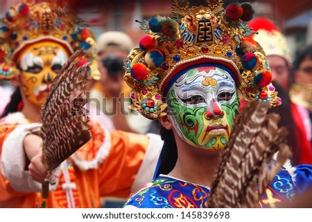 TAIPEI, TAIWAN-JUNE 20: The parade of Xiahai City God is host on June 20, 2013 in Taipei, Taiwan. Disciples play Infernal Generals in the parade. - stock photo