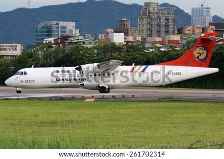 TAIPEI, TAIWAN - MAY 18:  A TransAsia Airways ATR 72-500 airplane taxis on May 18, 2014 in Taipei. TransAsia Airways is a private airline from Taiwan. - stock photo