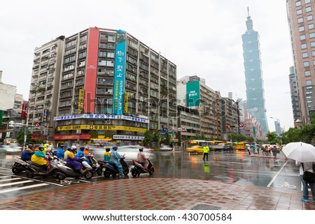 TAIPEI, TAIWAN - MAY 5: Raining day at Taipei modern city street on May 5, 2016. It is one of the latest modern district in Taipei with Taipei 101 near by