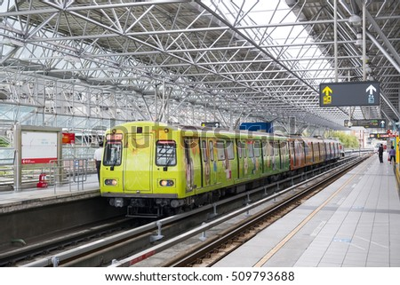 Taipei, Taiwan - May 22, 2014 : Street view of Taipei with metro train on the rail on May 22, 2014 in Taipei, Taiwan. the Taipei MRT is one of the best way to travel around the city