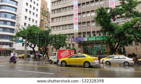 Taipei, Taiwan - Nov 23, 2016. People and vehicles running on street at downtown in Taipei, Taiwan. Taipei is capital city of the Republic of China (commonly referred to as Taiwan).