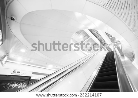 TAIPEI,TAIWAN - NOVEMBER 21: a escalator to get down the platform of the MRT, on November 21, 2014 in Taipei. The MRT serves 240,000 people daily and is one of the best way to travel around the city