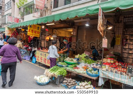 TAIPEI, TAIWAN - NOVEMBER 30, 2016: Taipei Street in one of suburb, district. Market Street in Taipei. Selling Vegetables.