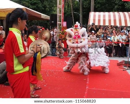 TAIPEI, TAIWAN-OCT 4: Lion dance is performed in the Northern Taiwan Mazhu Festival in Taipei, Taiwan on October 4, 2012. - stock photo