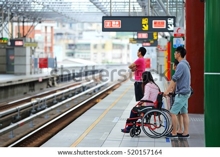 TAIPEI, TAIWAN - OCT 31: Passengers awaiting subway train at the Beitou Station on October 31, 2016 in Taipei, Taiwan