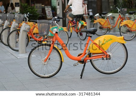 TAIPEI, TAIWAN - SEPTEMBER 9, Ubikes in Taipei on September 9, 2015. Ubike is a large network of rental bicycle in Taipei, Taiwan. - stock photo