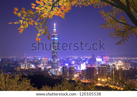 taipei 101, the tallest building mixed with nice maple in Taiwan - stock photo